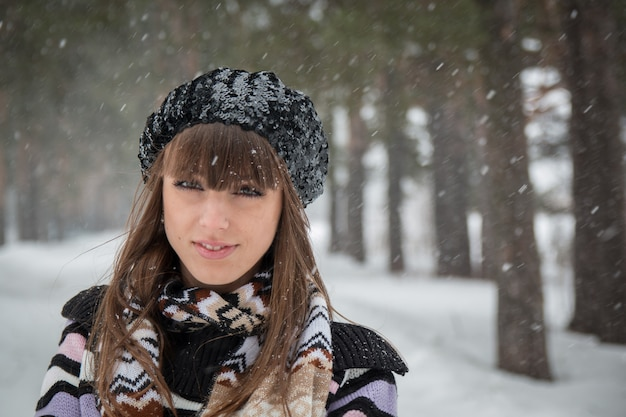 Portrait of beautiful girl in winter hat