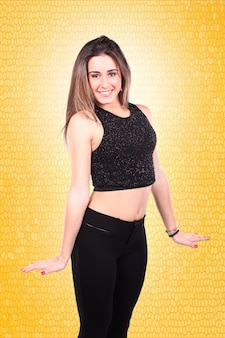 Portrait of a beautiful girl with long straight hair against a yellow background