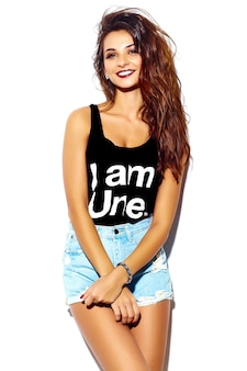 Portrait of beautiful happy cute brunette woman bad girl in casual hipster summer clothes