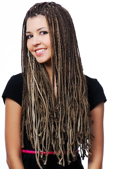 Portrait of beautiful happy girl with dreadlocks  isolated on white