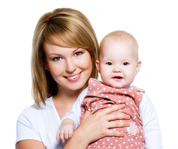Portrait of a beautiful happy mother with baby  isolated on white