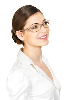 Portrait of the beautiful happy young  woman in glasses and white office shirt- isolated on white background