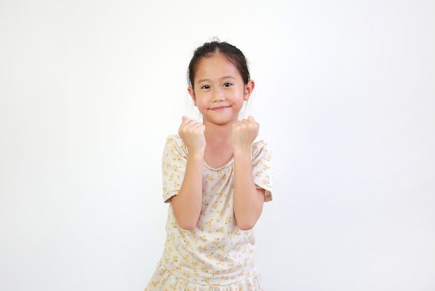 Portrait of beautiful little asian child girl with fight stance over white background