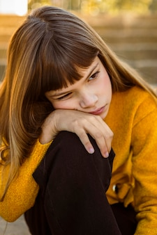 Portrait of beautiful little girl being bored Free Photo