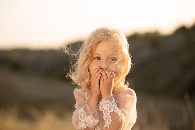 Portrait of a beautiful little princess girl in a pink dress