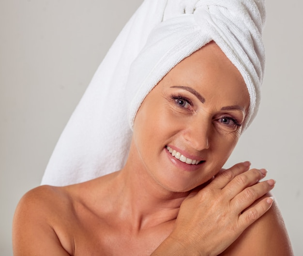 Portrait of beautiful middle aged woman with a towel.