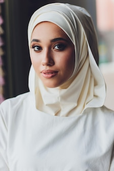 Portrait of a beautiful muslim woman in traditional islamic clothing and cover their heads