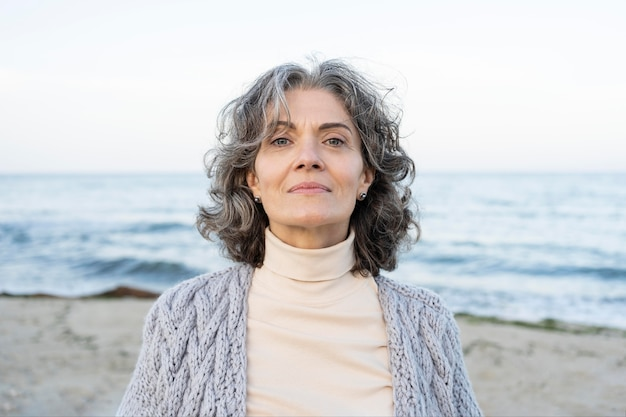 Portrait of beautiful older woman at the beach