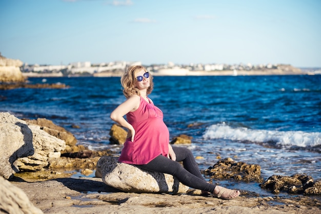 Portrait of beautiful pregnant woman at beach