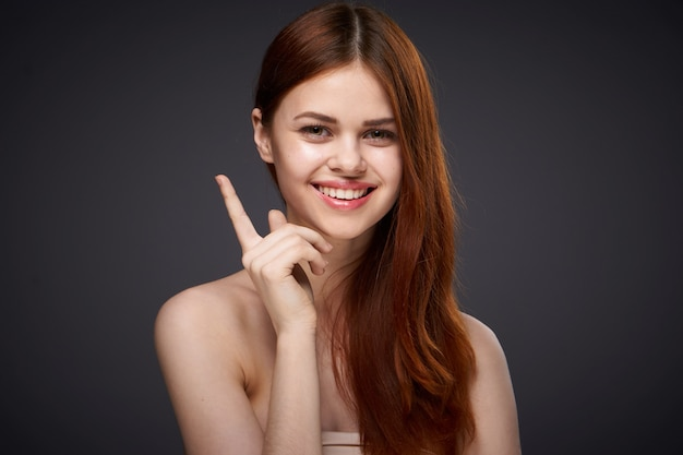 Portrait of a beautiful red-haired woman, beauty face