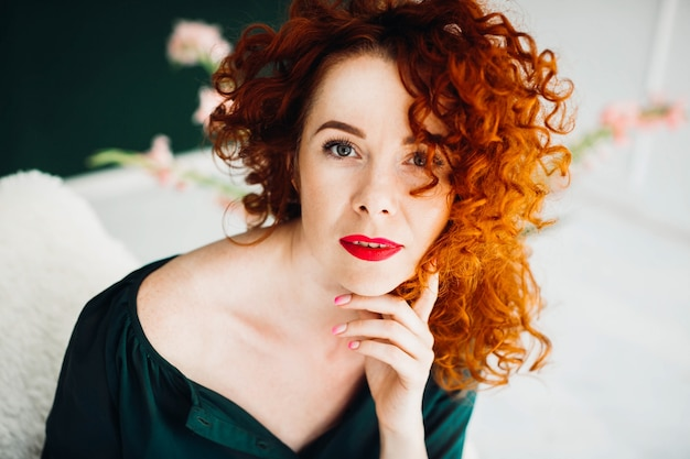 Portrait of a beautiful and red-haired young woman