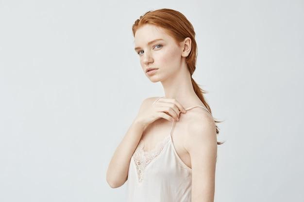 Portrait of beautiful redhead girl posing