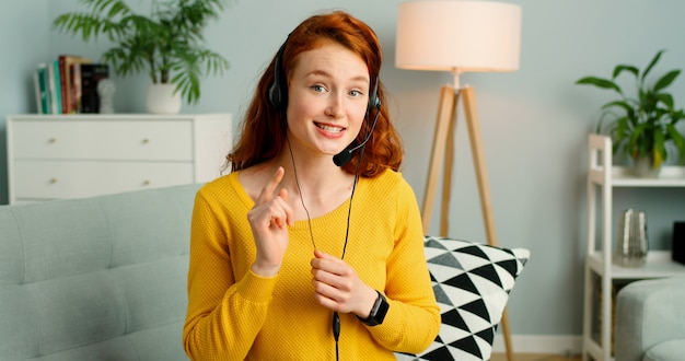 Portrait of beautiful redhead girl with headsets