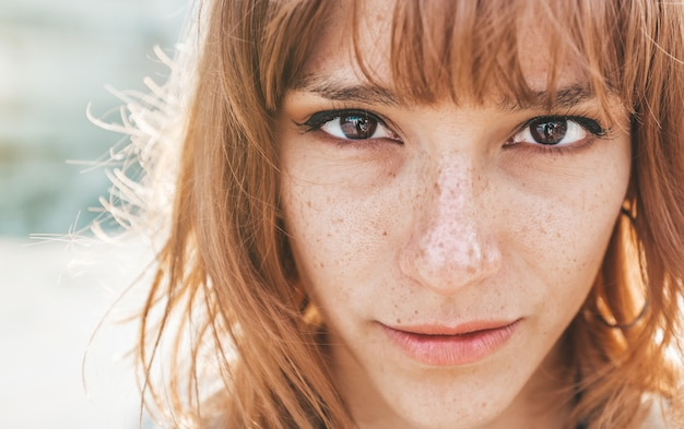 Portrait of a beautiful redhead woman looking at the camera. successful and powerful woman.