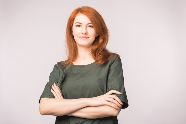 Portrait of beautiful redhead woman posing in white background