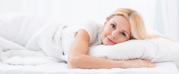Portrait of beautiful senior woman in bed