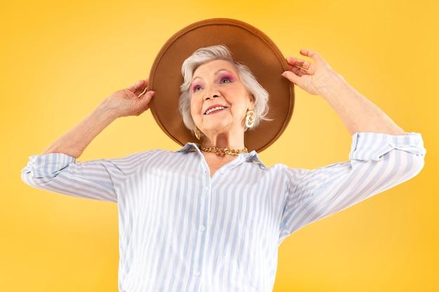 Portrait of beautiful senior woman being stylish