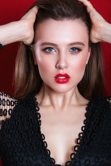 Portrait of beautiful sensual woman with red lips