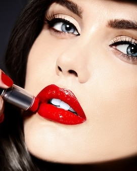 Portrait of beautiful sexy stylish caucasian young woman model with red lips