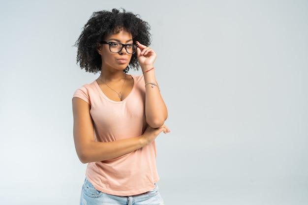 Portrait of beautiful smiling black woman in glasses.