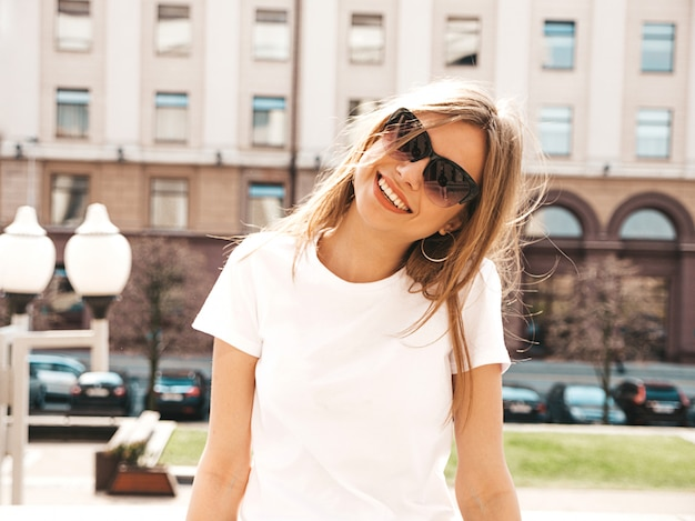 Portrait of beautiful smiling blond model dressed in summer hipster  clothes.