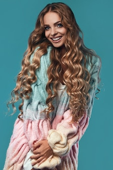 Portrait of beautiful smiling blond woman with long hair