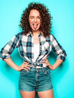 Portrait of beautiful smiling model with afro curls hairstyle dressed in summer hipster clothes.trendy funny and positive woman