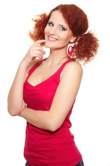 Portrait of beautiful smiling redhead ginger woman in red cloth isolated on white