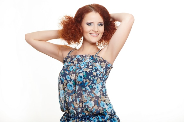 Portrait of beautiful smiling redhead ginger woman in summer dress isolated on white