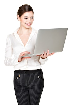 Portrait of a  beautiful smiling woman holds laptop on hands- isolated on white.