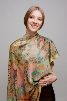 Portrait of beautiful smiling woman with colorful silk shawl