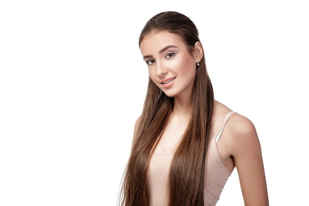 Portrait of beautiful smiling woman with long hair isolated on white background.