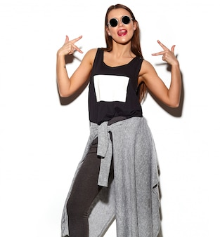 Portrait of beautiful stylish young woman with sunglasses