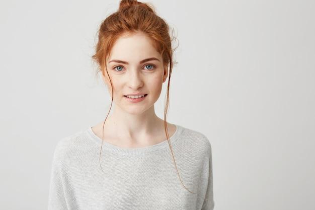 Portrait of beautiful tender ginger girl smiling posing .