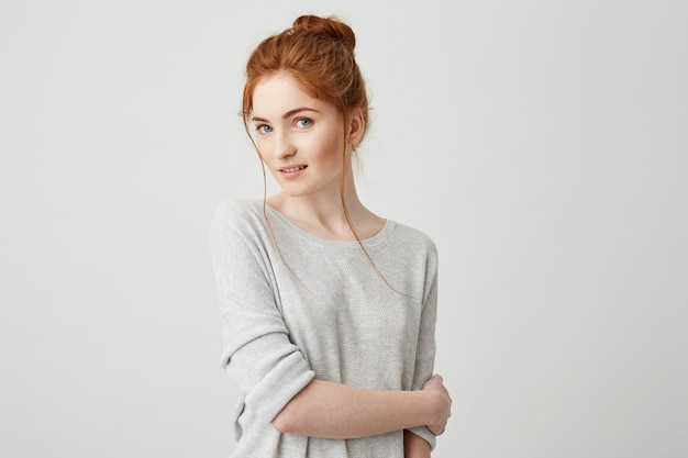 Portrait of beautiful tender redhead girl smiling posing .