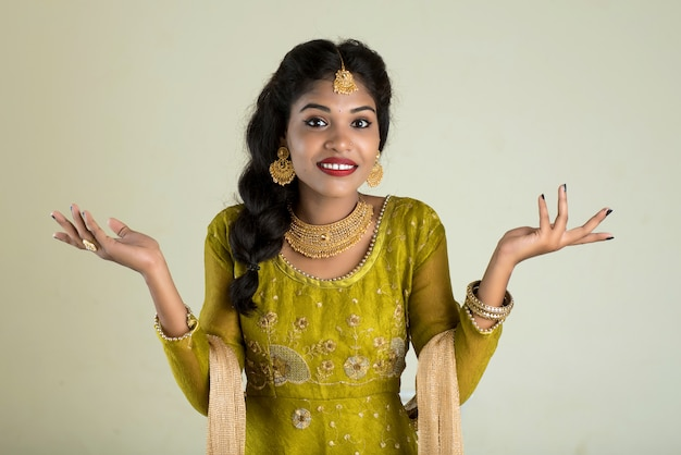 Portrait of beautiful traditional indian girl posing on white space.
