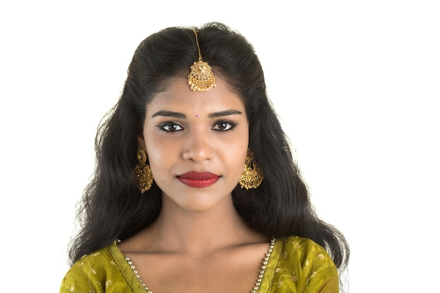 Portrait of beautiful traditional indian woman posing on white.