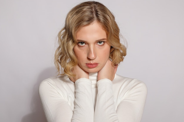 Portrait of beautiful transgender woman with blond hair