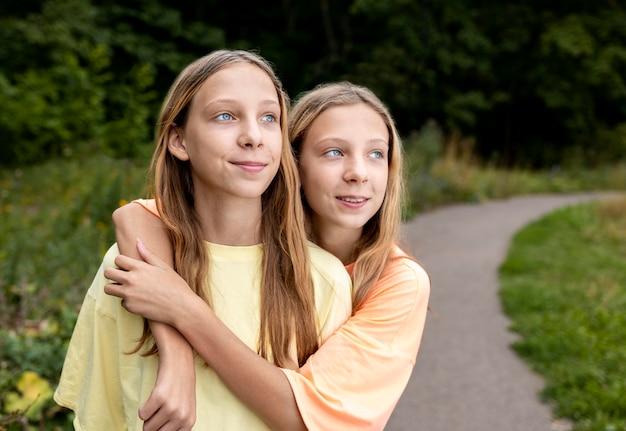 Portrait of beautiful twin sisters