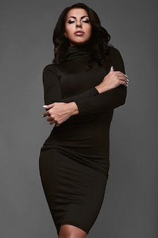 Portrait of beautiful woman in black classical dress