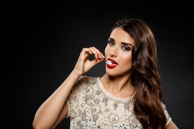 Portrait of beautiful woman  eating cherry