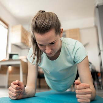 Portrait of beautiful woman exercising at home