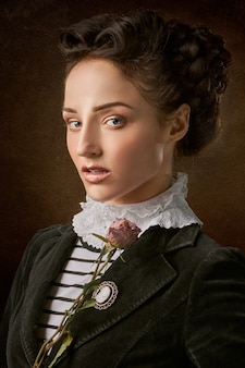 Portrait of the beautiful woman face with a rose