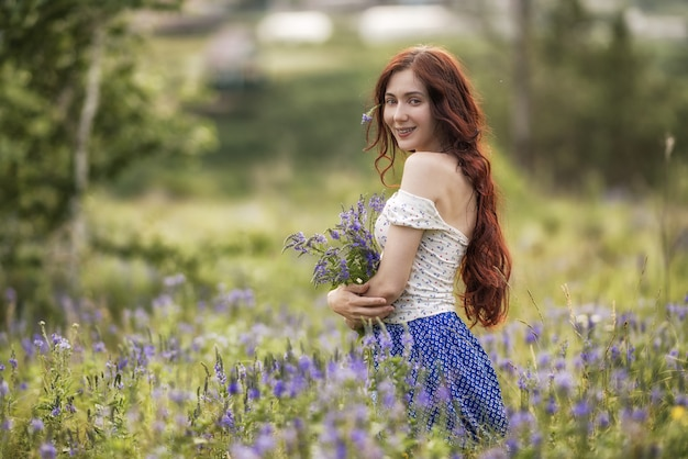 Portrait of beautiful woman in field