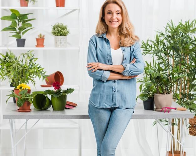 Portrait beautiful woman in greenhouse