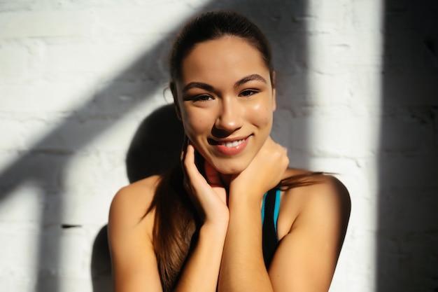 Portrait of beautiful woman. happy fit girl in sportswear laughing