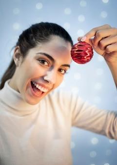 Portrait beautiful woman holding globe decoration