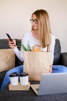 Portrait of beautiful woman holding paper bag