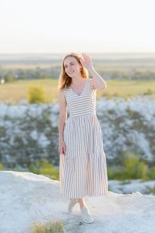 Portrait of a beautiful woman in a light brown dress