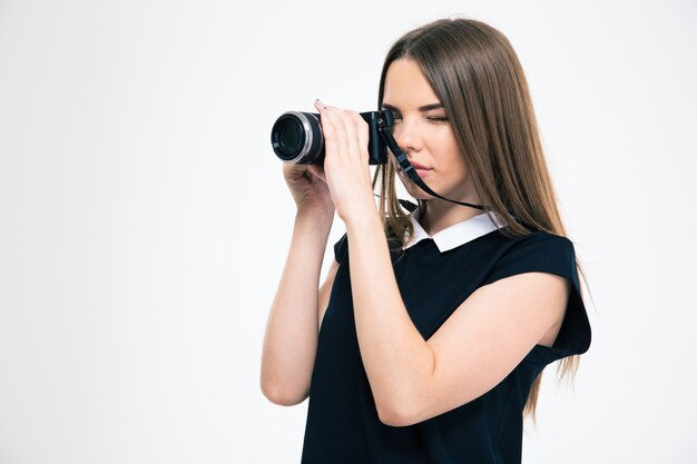 Portrait of a beautiful woman making photo on camera isolated